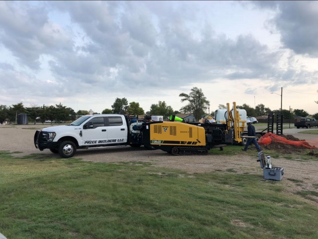 Price Builders truck and Vermeer D20x22